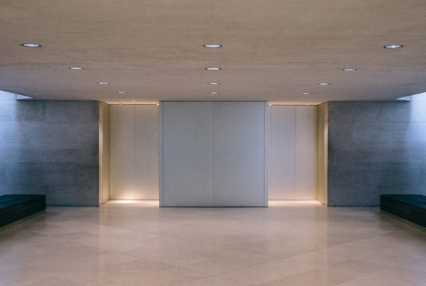 White elevators in a lobby with belbien film